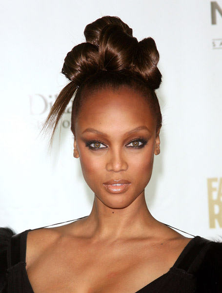25 updo hairstyles for black women known for being fierce and fabulous leave it to tyra banks to turn a simple bun hairstyle into something new and interesting instead of twisting hair pmusecretfo Images