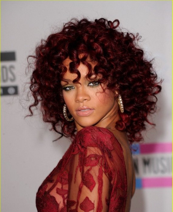 Rihanna Hairstyles rihanna hair cut rihanna hairstyles transformation Rihanna In Red She Looks Stunning In This Cocoa Cola Red Color We Love These Spiral Curls They Are Bouncy And Look Great On Any Face Shape