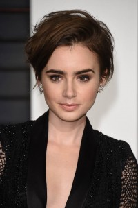 BEVERLY HILLS, CA - FEBRUARY 22: Lily Collins attends 2015 Vanity Fair Oscar Party Hosted By Graydon Carter at Wallis Annenberg Center for the Performing Arts on February 22, 2015 in Beverly Hills, California. (Photo by Venturelli/Getty Images)