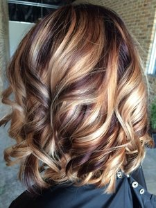 45 sunny and sophisticated brown with blonde highlight looks part 2 this warm two toned look is a knock out to recreate the models bombshell duo pair golden caramel highlights with darker curls for blowout look pmusecretfo Images