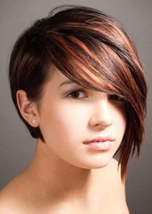 This dramatic style is short and reserved in the back, while long bangs sweep across the face in the front.