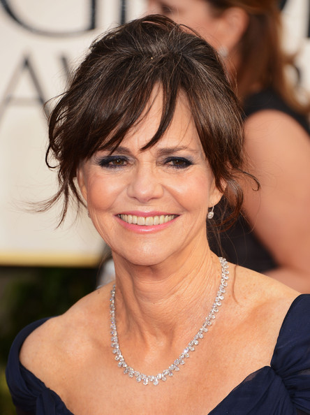 22 gorgeous mother of the bride hairstyles whether bangs are your usual look or youre considering a haircut before the occasion soft bangs add a nice touch to a loose or sleek updo pmusecretfo Images