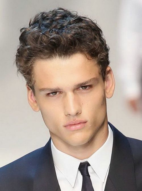 Hairstyles For Men With Thick Hair grooming mens hairstyles for thick hair This Style Leaves Hair On Top Long Enough To Show Off Its Natural Curl But Short Enough That You Wont Require A Ton Of Time And Product To Tame It Every