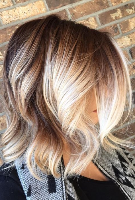 Blonde balayage hair colors with highlights balayage blonde part 21 a bold blonde balayage helps to accent the thick waves that have been styled into this auburn lob and make for an extra playful addition to your dark red pmusecretfo Image collections
