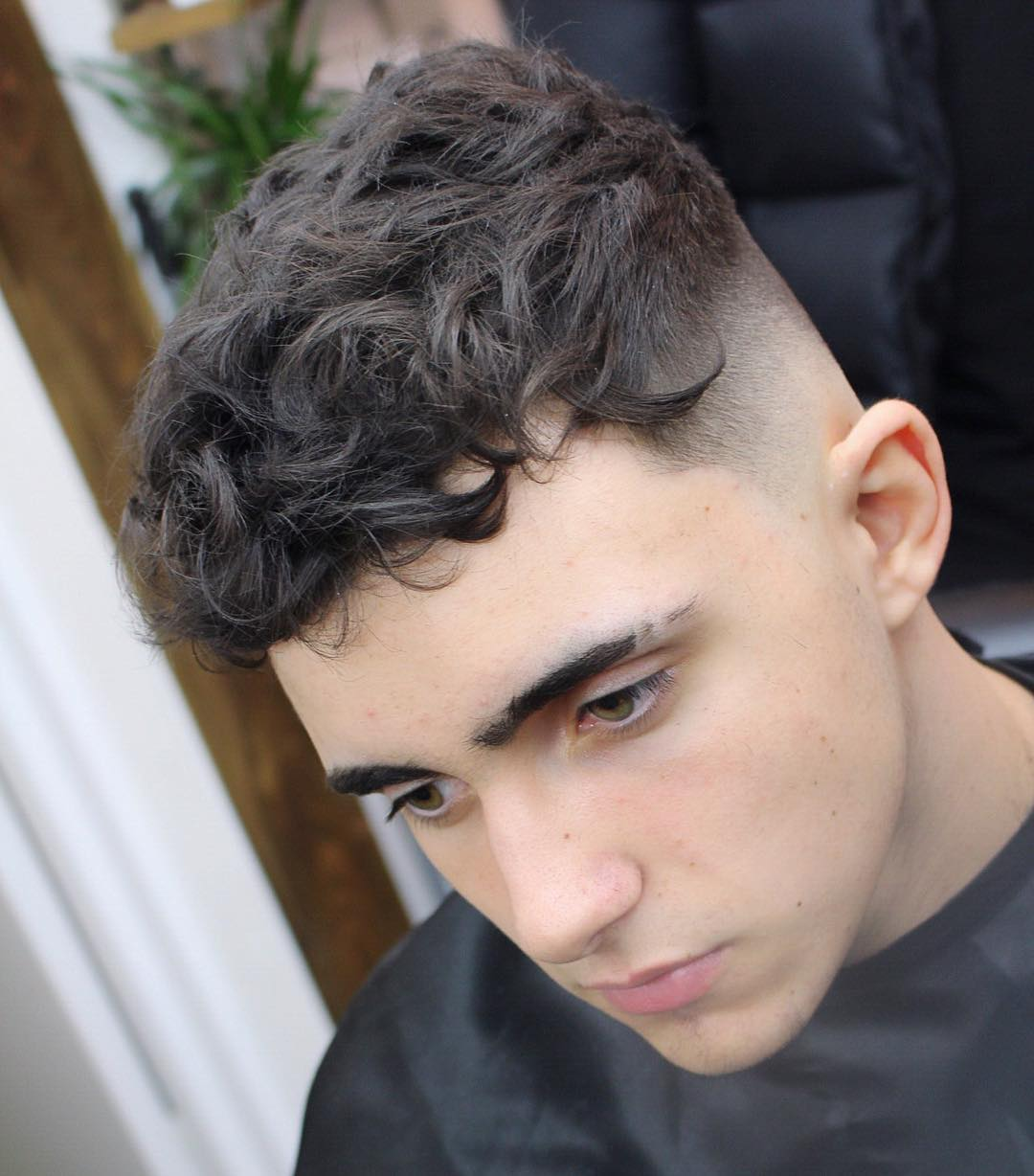 2017 05 side curls hairstyles - Combining Curls On Top With A Skin Fade Around The Back And Sides This Curly Hairstyle Is Perfect For Modern Men Who Want To Look Clean And Professional