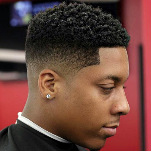 50 fade and tapered haircuts for black men 17low fade haircut with twists urmus Image collections