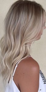 pale sandy blonde with roots