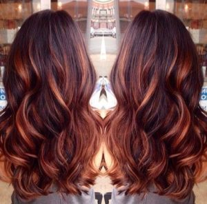 dark brown hair with caramel red highlights