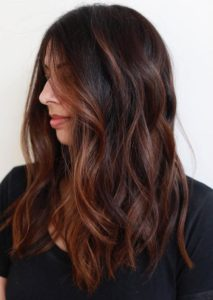 dark brown hair with copper balayage