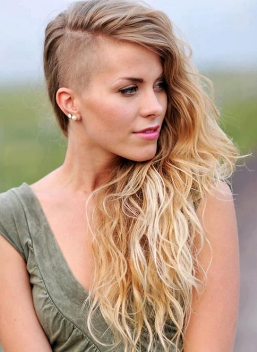 This blonde ombre look is a gorgeous example of how an undercut style can  look super feminine. Ultra long hair is left with natural dirty blonde  roots,