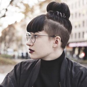 Shaved sides with bangs