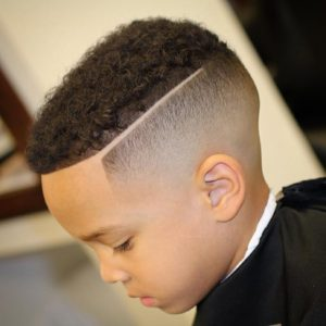 natural curls with skin fade hard part