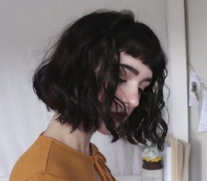 curly bob with short bangs
