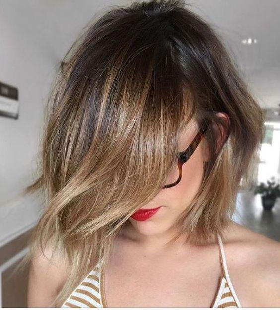 Blonde balayage with side bangs