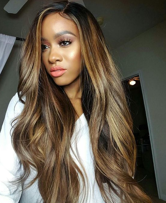 Hitting All The Right Notes Between Blonde And Brown This Ultra Long Sew In Hairstyle Features One Of Year S Gest Color Trends