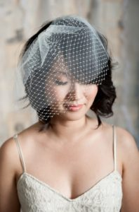romantic waves with birdcage veil