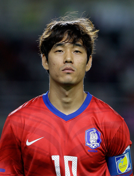 South Koreau0027s Park Chu Young Bucks The Trend Of Ultra Styled Soccer Haircuts  By Wearing His Mane In A Mid Length Tousled Style.