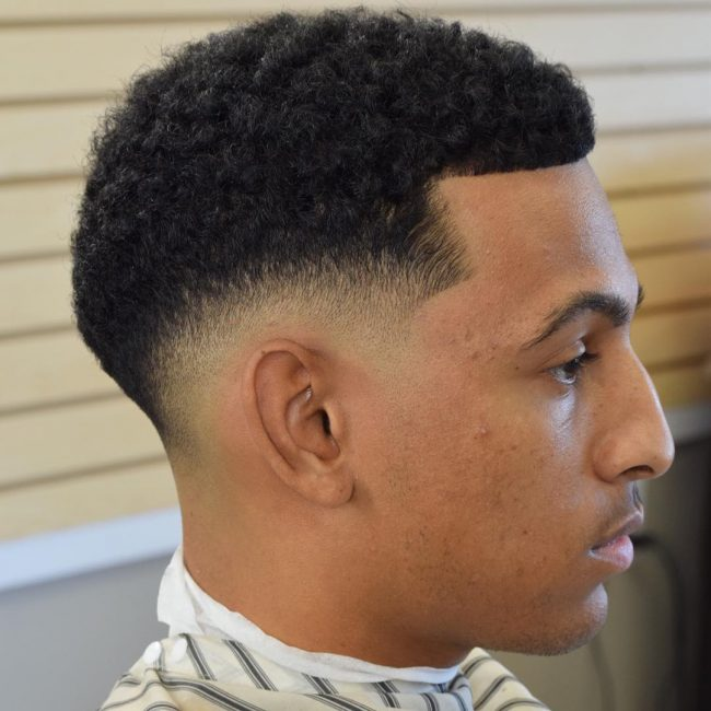 50 fade and tapered haircuts for black men this ultra low fade haircut style creates a fairly unique shape that were not used to seeing very often making it perfect for guys who like tapered fade winobraniefo Images
