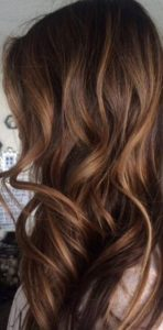 chestnut brown with golden balayage