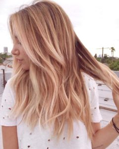 beachy blonde with red highlights