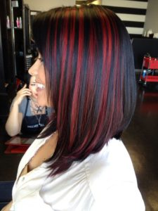 black hair with red peekaboo highlights