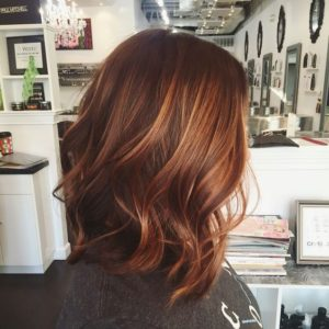 brown hair with auburn blonde balayage
