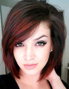dark brown hair with red highlights