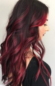 dark hair with magenta red balayage