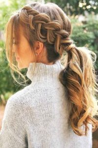 side braided hairstyle low ponytail