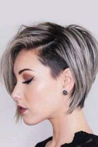 Pixie Undercut. Grays and Silvers are super trendy right now. This  asymmetrical Bob undercut has this edgy grunge vibes.
