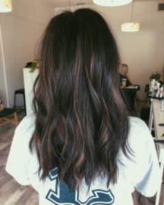 dark brown hair with blonde highlights