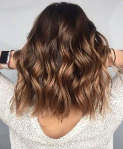 wavy medium brown hair with blonde highlights