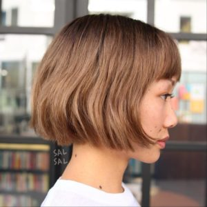 Cute Chocolate Blonde Bob with Bangs