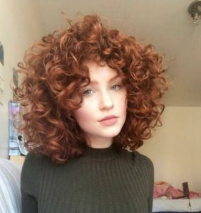Voluminous Curls with Face-Framing Layers