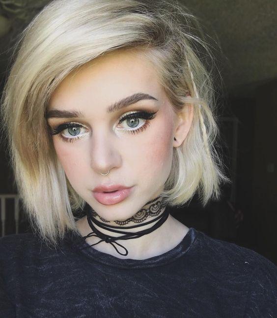 green girl eyes blonde hair dark