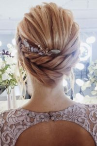 beautiful low braid with hair comb