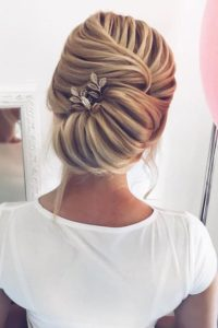intricately waved and styled bun