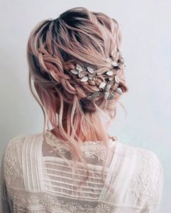loose updo with leaves accessory