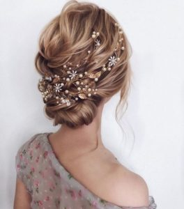 messy low bun with gorgeous hair accesssory