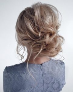 messy updo with hair vine