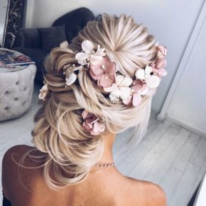 thick updo with flower pieces