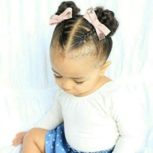 braided african american hair in pigtails