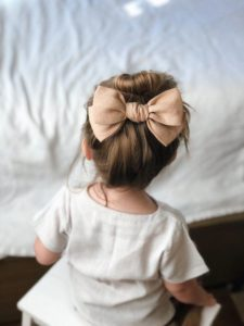 top bun with large bow