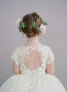 low bun with flower crown