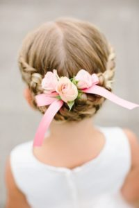 milkmaid braids with a bow and flowers
