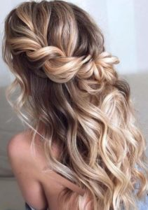 wavy half up hairstyle