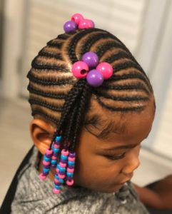 Ponytails and beads mix in cornrows