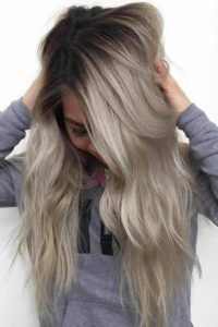 Long Ash Blonde Layers and Dark Roots