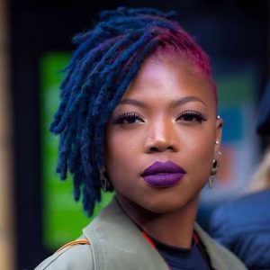 short blue pink side swept locs
