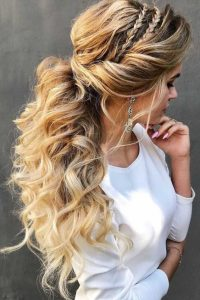 glam side braids tucked in